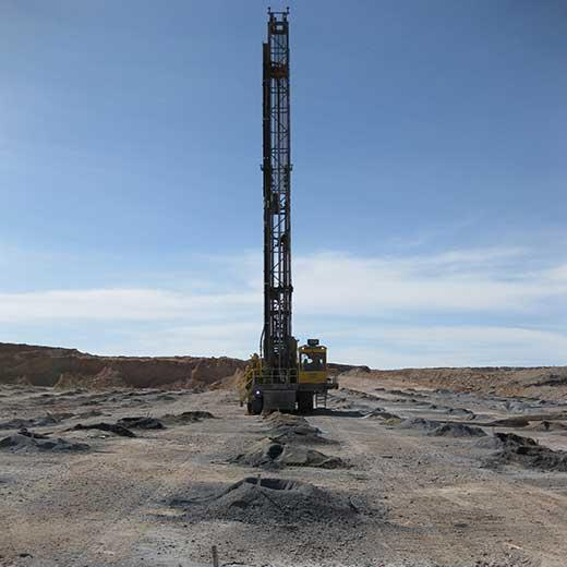 Machine drilling holes